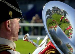 A military bandsman marks the minutes silence in honour of the Queen Mother
