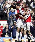 Arsenal players celebrate Ljungberg's goal