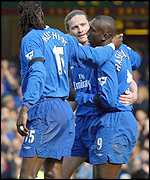 Mario Malchiot and Emmanuel Petit congratulate Jimmy Floyd Hasselbaink after his opening goal
