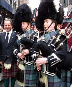 First Minister Jack McConnell with the pipers