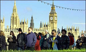 Queues of well-wishers along the South Bank of the Thames, with the Houses of Parliament behind