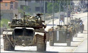 A convoy of Israeli army tanks and armoured personnel carriers drive in the West Bank town of Bethlehem