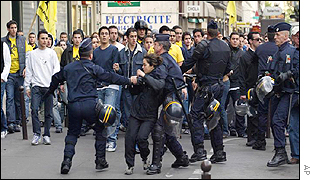 A demonstrator is arrested by French police