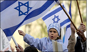 A child waves an Israeli flag during the protests