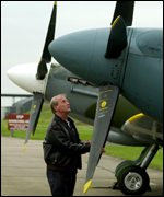 Squadron Leader Paul Day checks a Spitfire