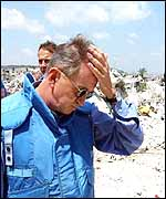 UN envoy Terje Roed-Larsen surveys the remains of the refugee camp