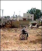 A Palestinian woman in a wheelchair abandoned on a street in Jenin