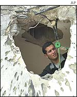 A man inspects damage done during a suspected Hezbollah raid in the village of Ghajar