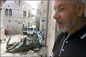 Palestinian man, wrecked cars