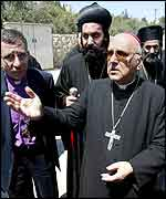 The Latin Patriarch of Jerusalem, Michel Sabbah, protests along with other clerics on Monday