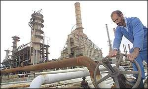 An Iraqi man at an oil pipeline