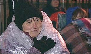 Woman in bubble wrap to keep warm