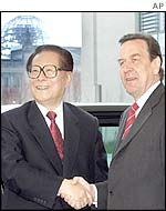 Chinas President Jiang Zemin, left, is welcomed by German Chancellor Gerhard Schroeder