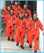 Crew enter the space shuttle Atlantis