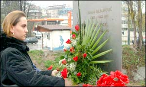 Edina Dilberovic lays flowers at the memorial of her sister Suada Dilberovic