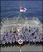 Ship's crews hold a two-minute silence