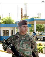 A soldier guards an oil refinery