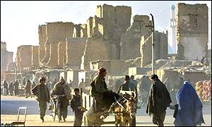 People walk past the bombed buildings of Afghanistan's capital, Kabul.
