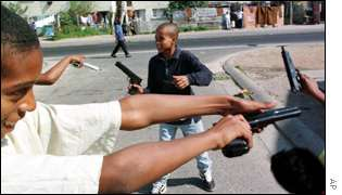 Children play with toy guns