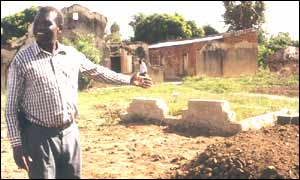A former aide of Idi Amin shows the family burial ground in Arua