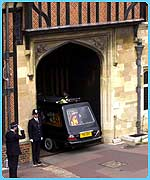 The hearse carrying the coffin of the Queen Mother enters the gates of St George's Chapel in Windsor Castle