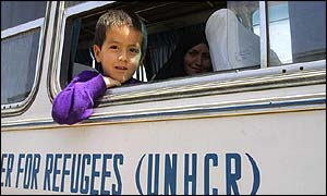 Afghan refugees in Iran on a UNHCR bus to return home