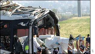 Victim of suicide bomb attack being extricated from wreckage of Israeli bus
