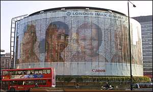 The image is wrapped around a cinema in London