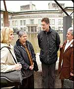 (L - R) Sehida Abdurchmanovic, Hajra Catic, unidentified man, Munira Subesic and Hasja Selinovic stand in front of the international war crimes tribunal in The Hague, 09 April 2002.