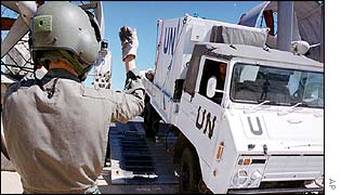 Japanese peacekeeper oversees the unloading of a UN vehicle in East Timor
