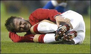 Beckham looks in serious pain as he lies injured waiting for the physio to arrive