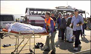 A bus bomb victim is removed
