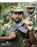 Tamil Tiger soldier guarding press conference