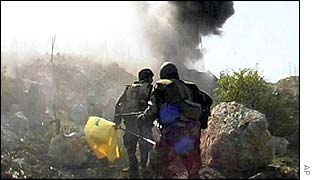 Hezbollah attacking Israeli position in disputed Shebaa Farms area in April 2002