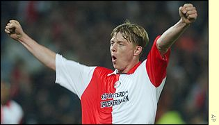 Feyenoord's Jon Dahl Tomasson celebrates after he scored the second goal