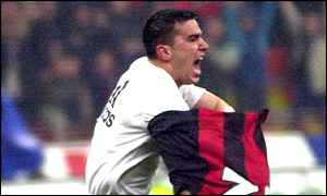 Milan's Romanian star Cosmin Contra celebrates his goal which made it 2-0