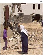 Palestinians among rubble in Jenin