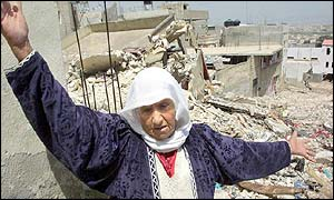 Palestinian woman among debris in Jenin