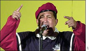 Hugo Chavez, wearing paratrooper's beret, speaks on national TV on 9 April