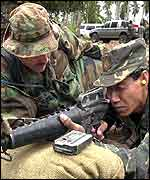 Teaching a Philippine soldier firing technique in Lamitan