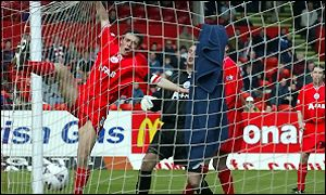 Aberdeen's defence cannot prevent Andy Tod's header entering the net