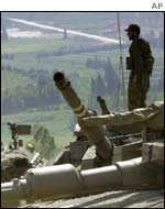 Israeli troops survey the border with Lebanon