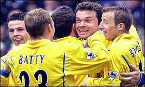 The Leeds team mob Mark Viduka after he opened the scoring against Aston Villa with a delightful goal