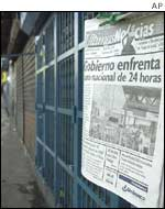 A newspaper pinned up on a gate