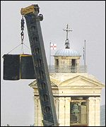 A speaker emitting a high-pitched sound is hung close to the church
