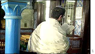 A member of Tunisia's Jewish community prays at the Ghriba synagogue on 13 April