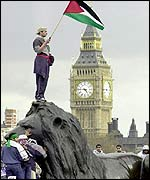 Protester holds Palestinian flag