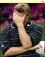 Ernie Els from South Africa, reacts on the 13th green after carding an eight