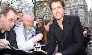 Actor Hugh Grant signs autographs outside the Empire Leicester Square