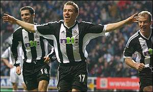 Craig Bellamy celebrates a goal for Newcastle